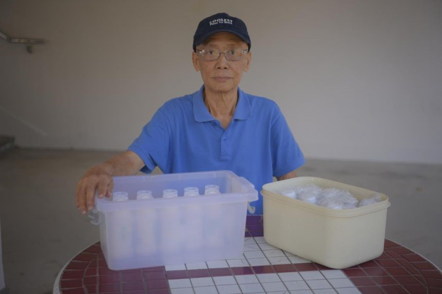 Retiree Lee Meow Khin with his medicine delivered to his home.ST PHOTO MARK CHEONG